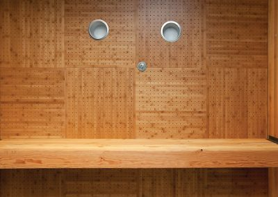 Wood ceiling tiles with standard perforation pattern installed at Cal State University, San Marcos